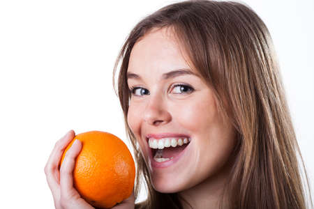 Portrait of young woman holding fresh orange  photo