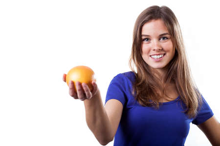 Portrait of healthy woman holding fresh orange photo