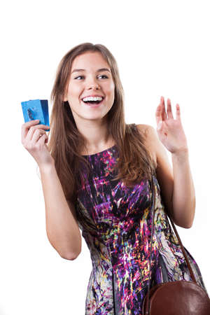 Happy woman waving to someone during shopping photo