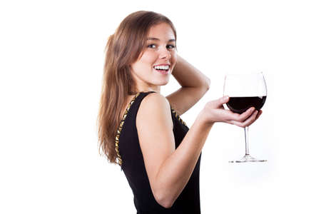 Cheerful girl holding glass with red wine photo