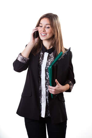 Businesswoman standing with briefcase and phone on her hands photo