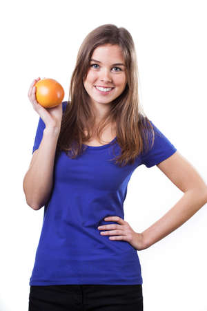 Beautiful girl dressed in blue t-shirt and holding orange photo