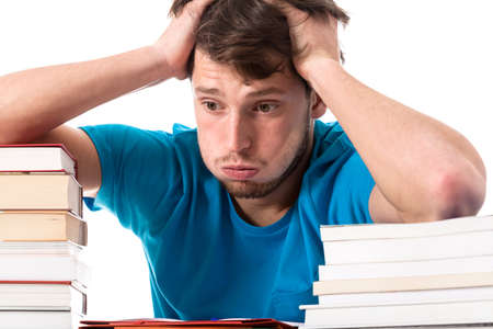 studing: A terrified student about to start studing for an exam Stock Photo
