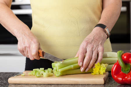 pices: Person is chopping vegetables in small pices