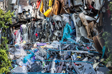 salvage yards: Piled up compressed cars about to be recycled