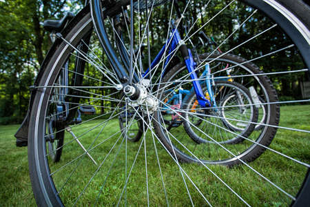 Multiplication of bike spokes of several vehicles put together in one line photo