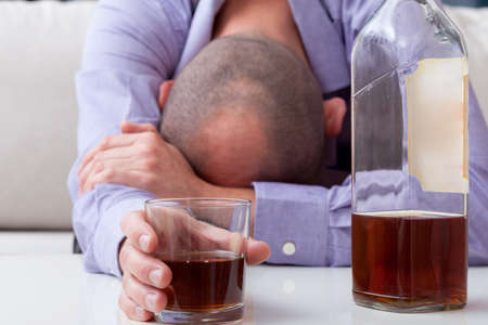 irresponsible: Drunk man in shirt sleeping on the table