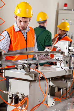 storekeeper: Production workers doing job during production process  Stock Photo