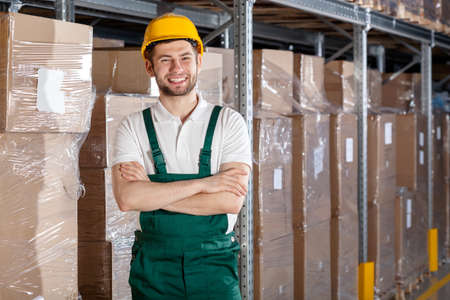 storekeeper: Factory worker in warehouse with founded hands Stock Photo