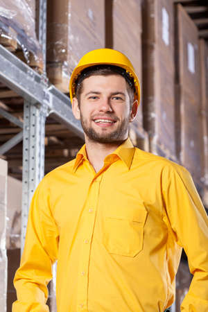 Young supervisor during his job in warehouse photo
