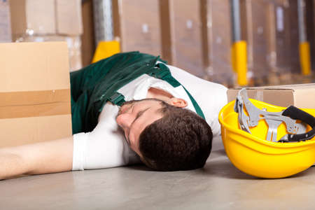 accident at work: Dangerous accident at work in factory warehouse Stock Photo