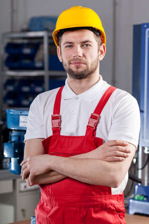 warehouseman: Young production worker during job in factory