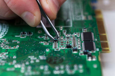 electronic circuit: close up of repairing circuit printed board Stock Photo