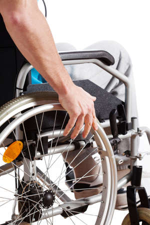 Man after an accident sitting in a wheelchair Stock Photo - 26238439