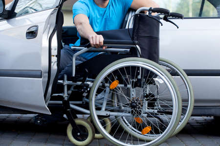 ability: A handicapped car driver with a wheelchair
