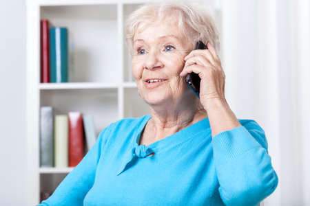 Talking on the phone: Senior woman during talking on mobile phone Stock Photo