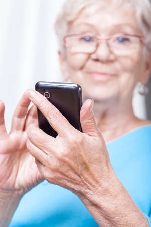 lady on phone: Senior lady during using cellular phone application