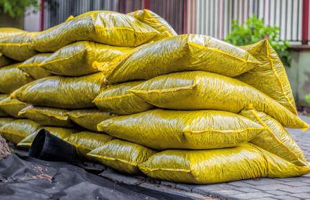 mulch: Heap with bags full of garden bark