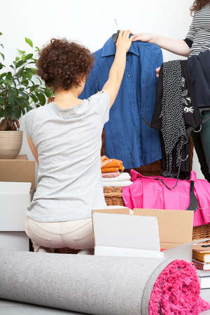 woman closet: A woman doing a clean up in her fashion closet Stock Photo