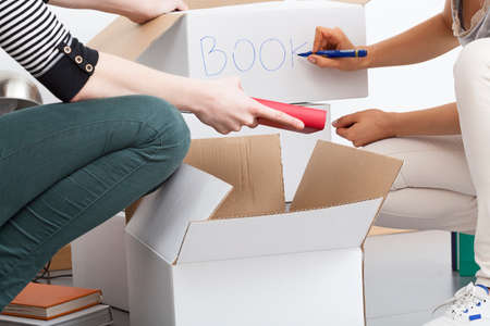 unneeded: A close up of putting all unneeded knick-knacks into boxes Stock Photo