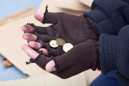 Homeless mans stretching out hands for a money photo