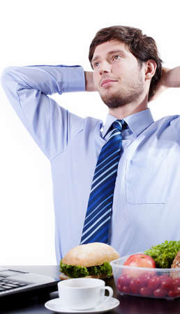 Businessman getting rest and eating lunch during his break Stock Photo - 26312882