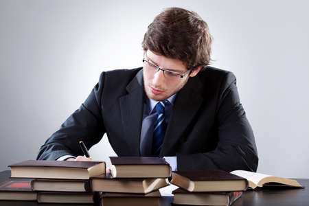 law office: Law student working hard before an exam