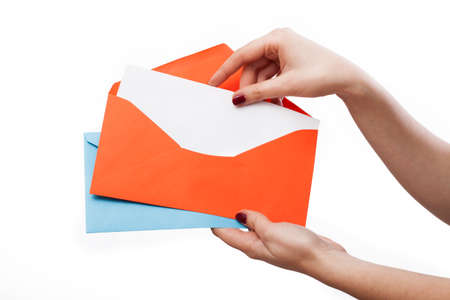 letter envelope: Hands holding colourful envelopes with a withe page for your text