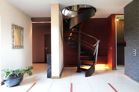 A modern staircase in a luxurious hall with a brickwall photo