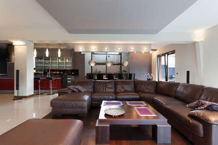 Huge brown sofa in a living room photo