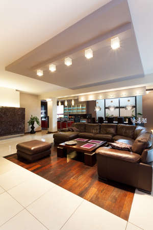Huge leather sofa in a spacious living room photo
