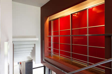 A moder red wardrobe area on the first floor photo