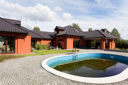 An elegant mansion with a swimming pool outdoors photo