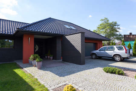 A house with a garrage and parking space