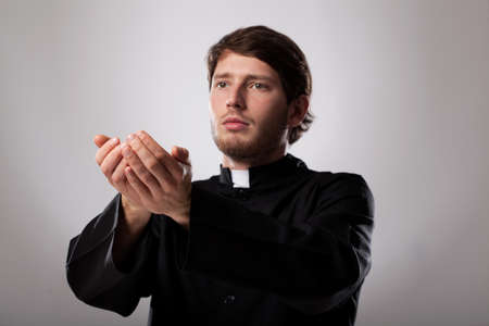 Young christian faithful priest is preaching a sermon