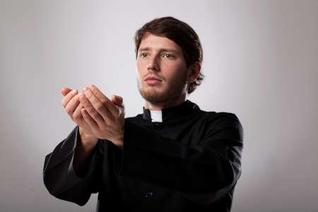 preaching: Young christian faithful priest is preaching a sermon