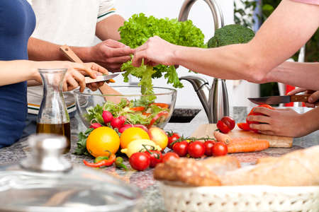 Family preparing lunch together at home photo