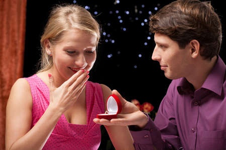 rose ring: A man surprising his girlfriend with a proposal Stock Photo