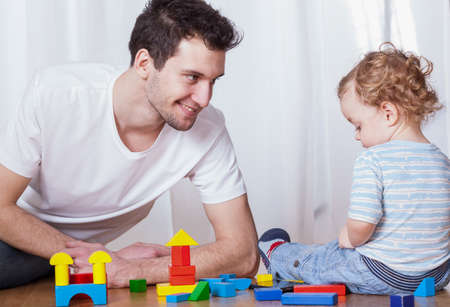 babysitter: Young dad having fun with his son