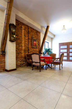 Entrance hall with brick wall in hotel interior photo