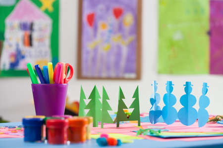 kindergarden: Colourful cutouts, pens and paints in a kindergarden