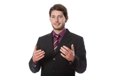 Young successful businessman during speaking something important