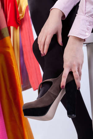 woman closet: Woman trying her new  stylish high heels