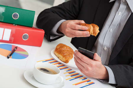 coffe break: Manager with a smartphone on a coffe break