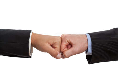 consensus: Fists of two people holded close together as a friendly sign