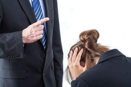 violence in the workplace: Boss threatening with finger his employee, isolated