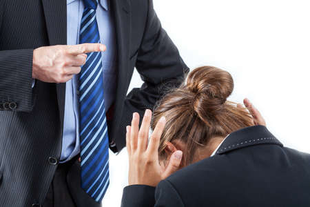 Boss putting his finger in front of an employee to bully her