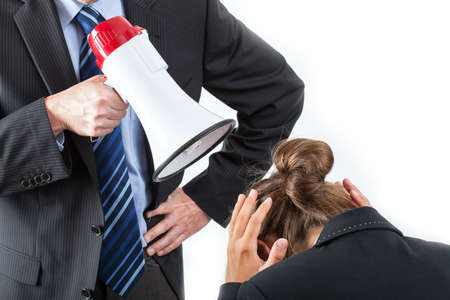 violence in the workplace: Boss yelling at employee through megaphone