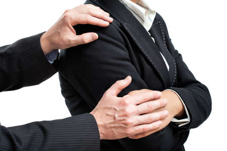 apologise: Manager comfort his friend holding his hands Stock Photo
