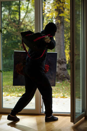 swindler: A thief escaping through the window with a stolen painting